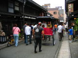 Tourists in a Sanmachi rickshaw