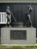 Statuary beside a sake brewery