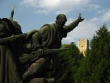Partisans sculpture with castle tower