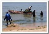 Fishermen launching from the beach