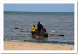 Small fishing boat - note the oars