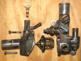 Thermostat and thermostat housing