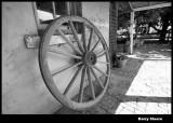 Wagon wheel on the homestead wall