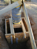 The base is 32 in. by 32 in. by 42 in deep. The column is 48 in. tall and 12 in. in diameter. The hole was backfilled prior to pouring.