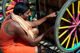 Repairing his Tricycle