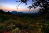 Misty sunset over the vast rolling plain