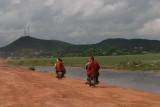 monks on motorbikes
