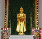 Small Buddha image outside temple