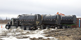 Water carrying trucks used in winter road construction