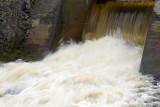 Slow exposure shot of water at dam along Highway 573