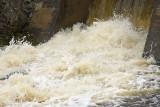Faster exposure shot of water at dam along Highway 573