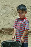Boy near the Hosseinieh