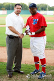 Chris Allen, COO of the South Coast League, presents Ismael Castro with the Peach State Series MVP award.