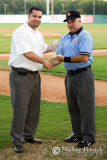Chris Allen, COO of the South Coast League, presents Ron Russo with the Umpire of the Year Award