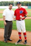 Chris Allen, COO of the South Coast League, presents Scott Robinson with the league MVP award.