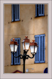Four Blue shutters and a Lampost
