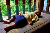 1061 Child sleeping in a drum tower.