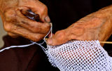 2538 Hands that make the fish net. Local cotton is used.
