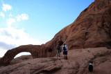 Hiker descends arch