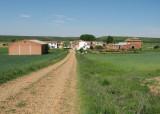View of the shadeless dirt way to Calzadilla de la Cueza