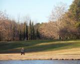 Two public servants walk beside the lake