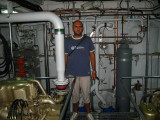 Massimo inside the machine room of a Guardia di Finanza boat