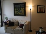 Loveseat and Bruce Ricker painting