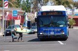Surfer boarding the 101 Bus
