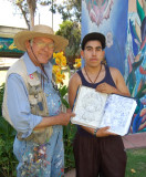 Salvador R. Torres encourages a young painter