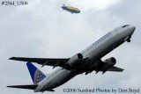 Continental Airlines B737-924 N72405 with Goodyear Blimp in background airline aviation stock photo #2544