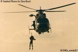 Late 80's - USCG HH-65 #6525 hoisting Coast Guard Reserve air crew member during wet drill