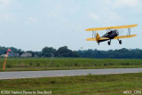 Joe Pendergrass' Boeing A-75 Stearman N1715B picking up ad banner private aviation stock photo #6311
