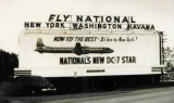 1955 - National Airlines billboard in Miami advertising new DC-7 Star service to New York, Washington and Havana