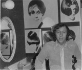 Santilli standing in front a collage of  Vidal Sassoon work from the other day