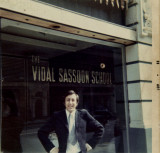 Santilli at his work place, before the school moved to Davies Mews modeling one of Reggies Kipper ties