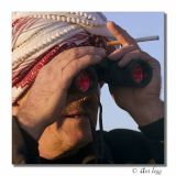 Najim with binoculars and cigarette