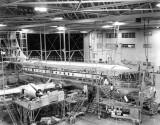1950 - Pan American B-377 Stratocruiser undergoing maintenance at Miami