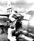 1950 - Engine maintenance on a Pan American Airways Boeing 377 at Miami International Airport
