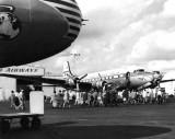1949 - Passengers walking across the ramp to board a Pan American DC-4