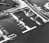 1930 - Pan American Airways System Consolidated Commodore passing over piers of Miami yachting clubs