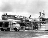1949 - Mechanics working on Pan American Boeing 377-10-26 N1028V Clipper Flying Cloud at Miami International Airport