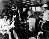 1930 - Passengers onboard a Pan American Airways System Consolidated Commodore