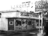 1968 - Weinkles Liquors and a Royal Castle sign at 12425 S. Dixie Highway, Miami