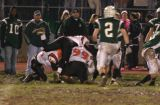 aylward, jones, and chapman make the tackle
