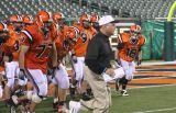 coach suriano leads his team into the jungle
