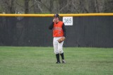 ethan keeps his hands warm in right field
