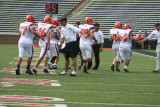 coaches congratulate offense after td