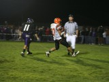 elijah carries the ball into the end zone