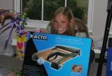 alex LOVES her new paper cutter