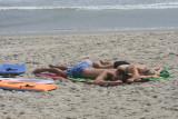 michael and alex asleep on the beach